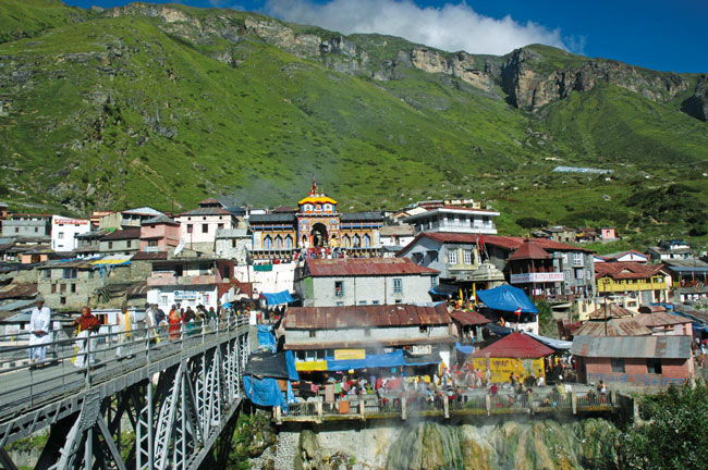 Badrinath India  city pictures gallery : The first view of Badrinath Temple from across the bridge over the ...